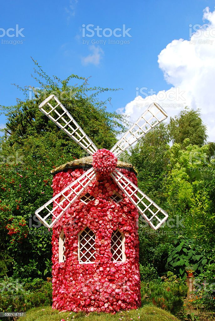 Decorative Windmill made of rose flowers.. stock photo
