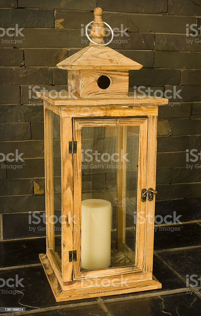 Decorative wooden cage with candle stock photo