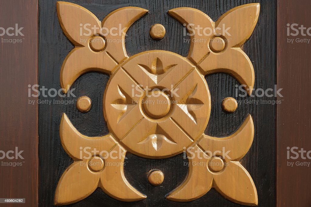 Decorative Wooden Panel With Abstract Woodcarving Ornament stock photo