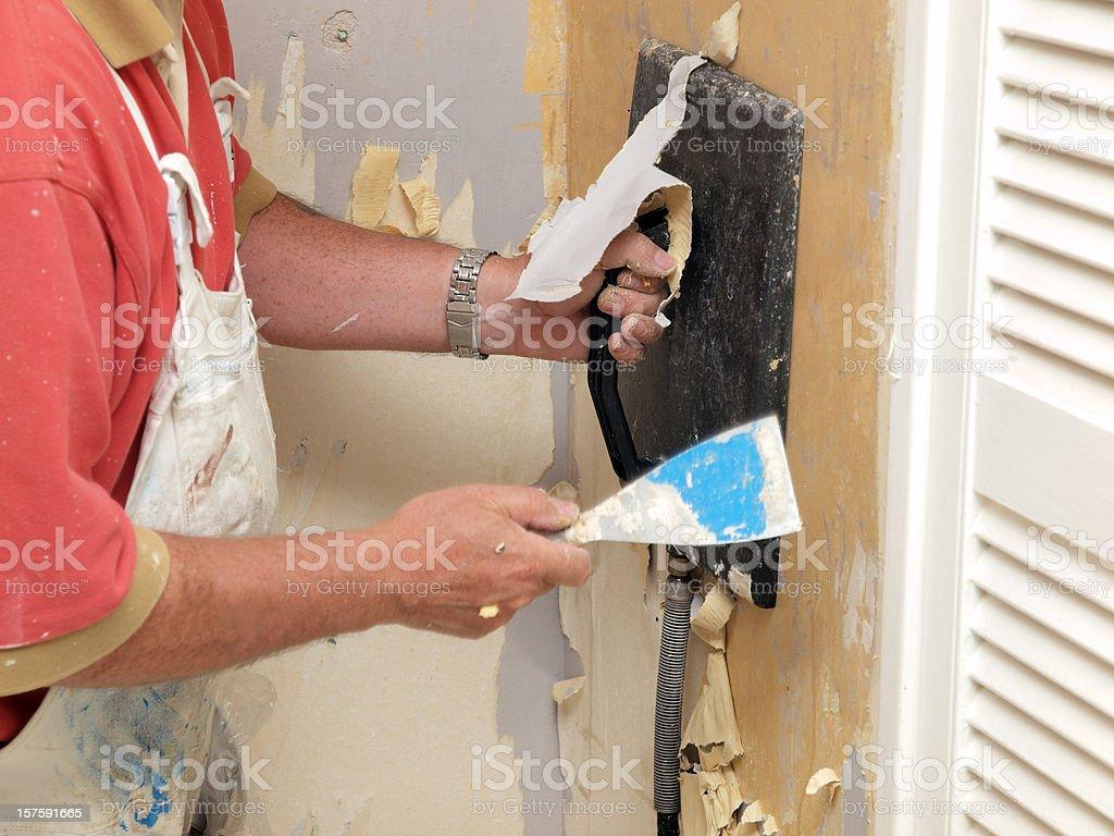 Decorator Stripping Wallpaper stock photo