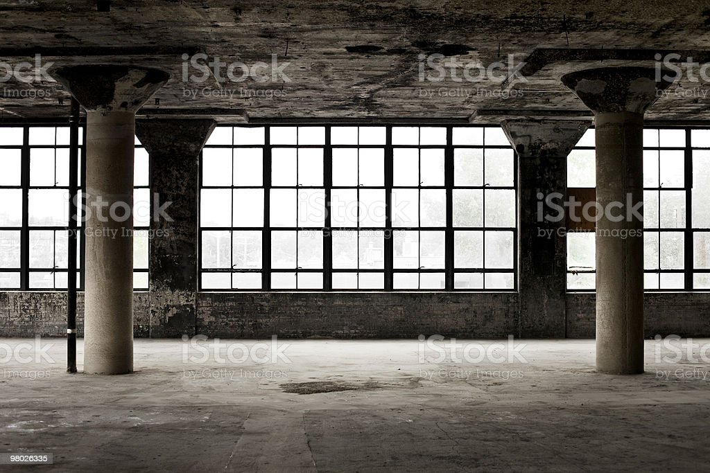 Decrepit industrial loft with columns and windows stock photo