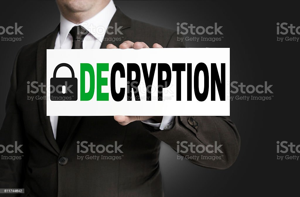 decryption sign is held by businessman stock photo