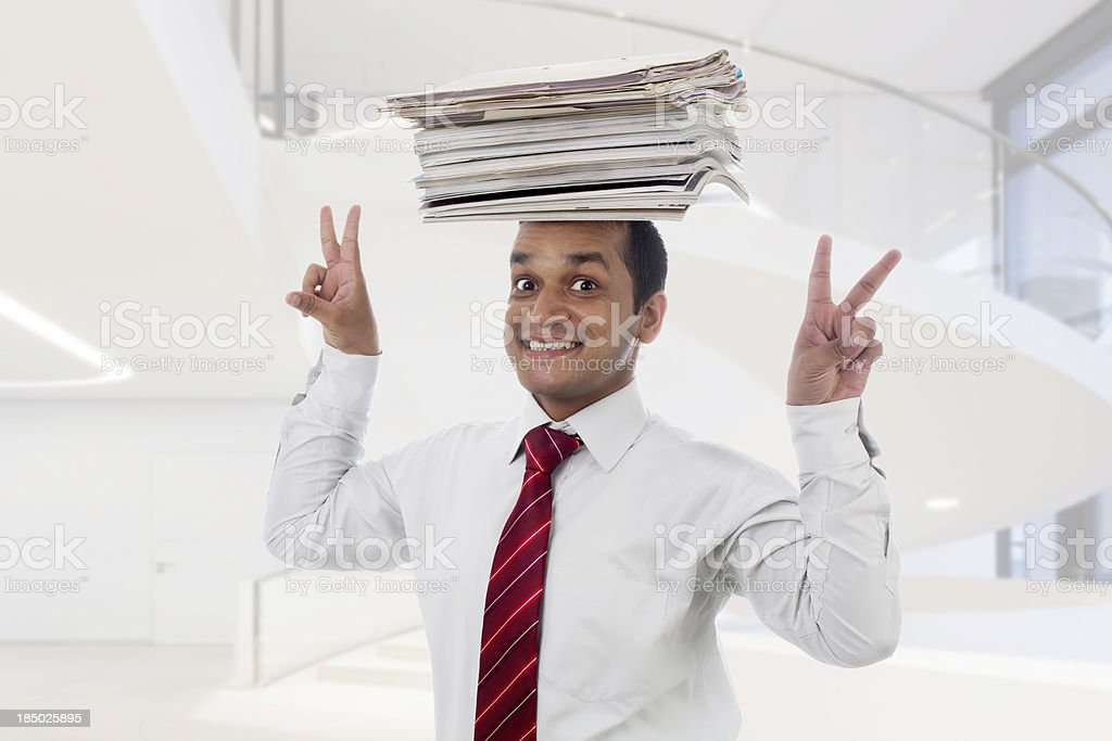 Dedicated Indian businessman or executive happy to get more responsibilities stock photo