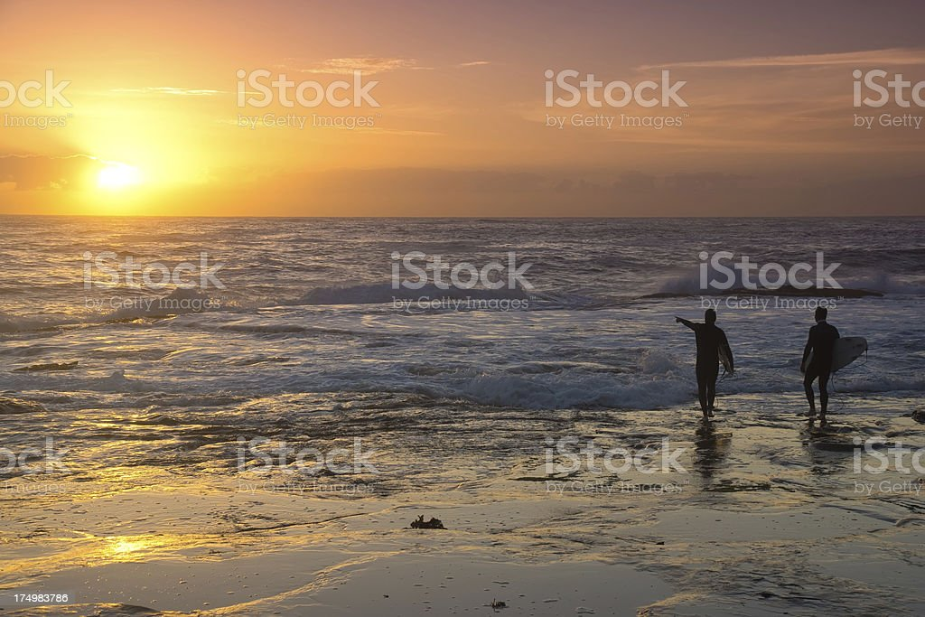 Dee Why Beach - Surfers at sunrise royalty-free stock photo