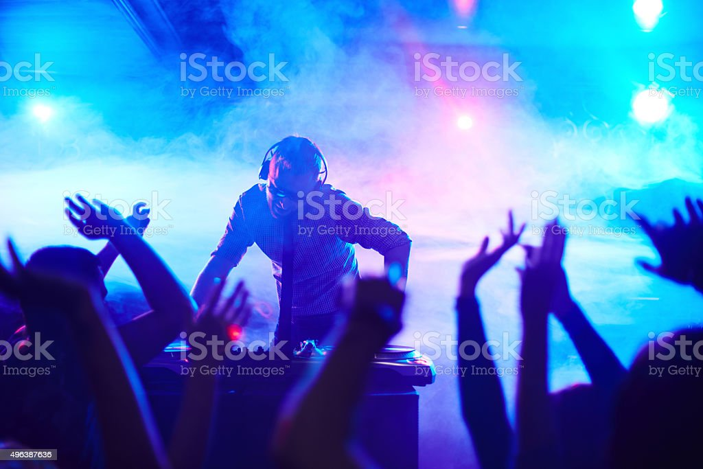 Deejay in club stock photo