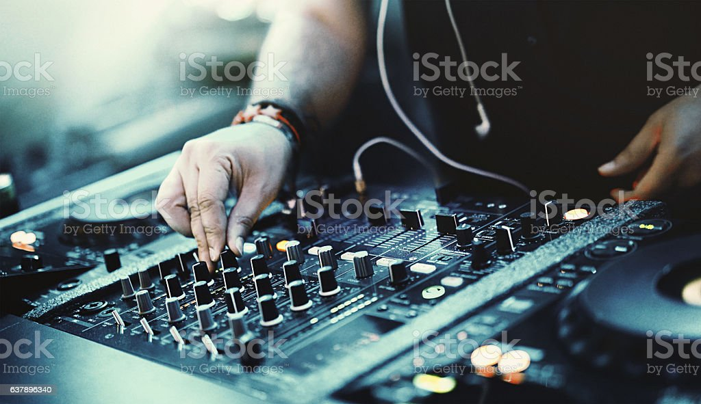 Deejay playing music at a party. stock photo