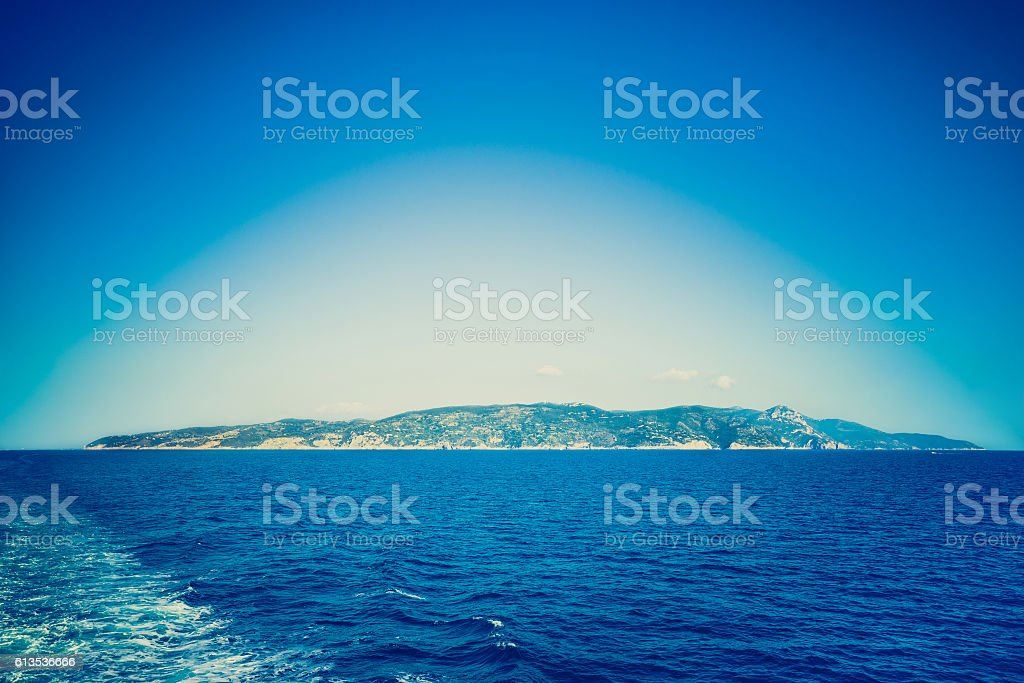 Deep blue filtered vignetted panorama view of Argentario peninsula Italy stock photo