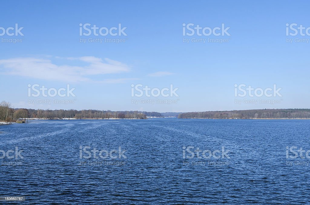 Deep blue horizon over winter river or lake surface royalty-free stock photo