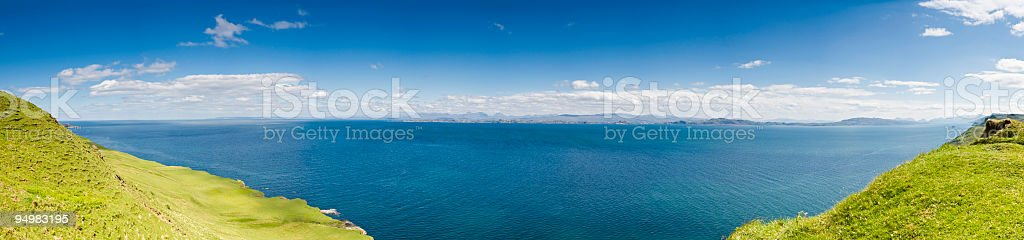 Deep blue ocean green shore royalty-free stock photo