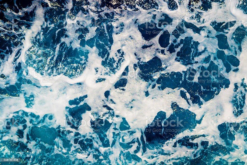 Deep blue sea water with spray stock photo