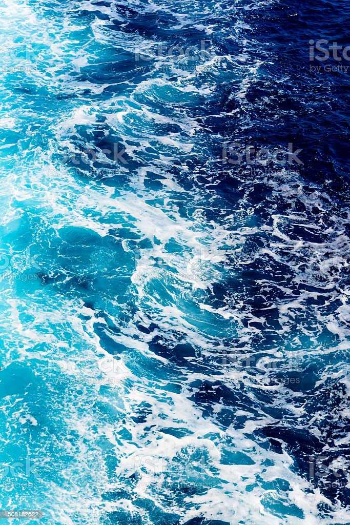 Deep blue sea water with spray stock photo