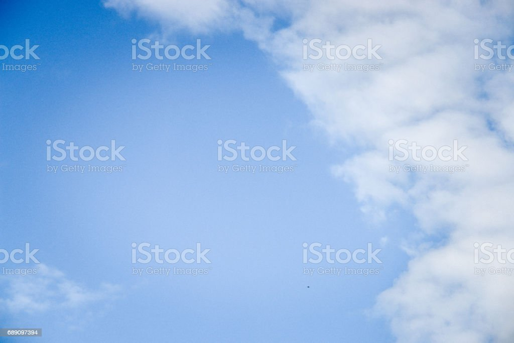 Deep blue sky texture background with white clouds and copy space. stock photo