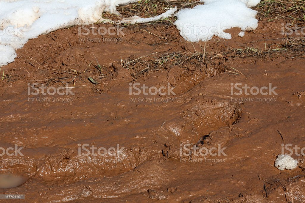 Deep brown disgusting mud and snow stock photo