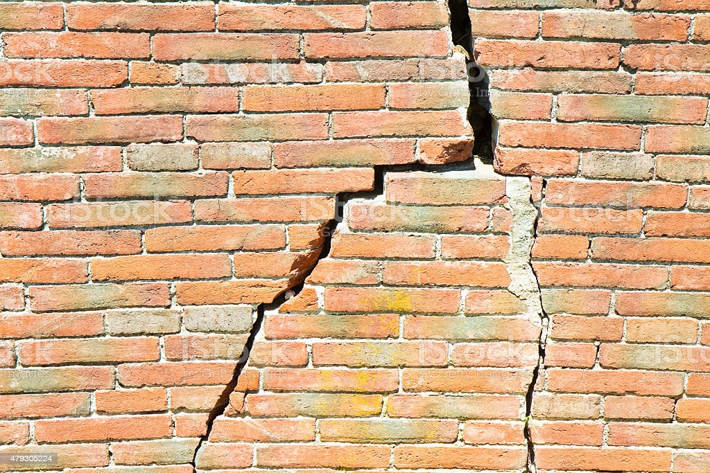 Deep crack in old brick wall stock photo