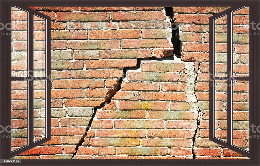 Deep crack on brick wall view from a window stock photo