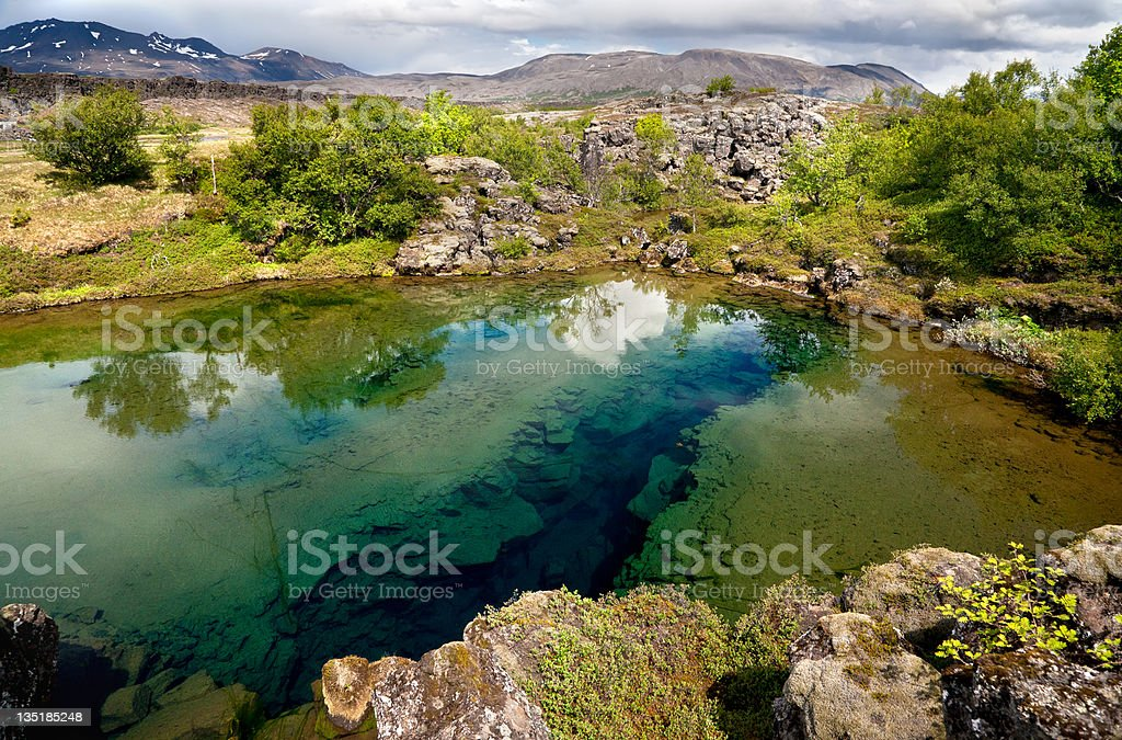 Deep fissure in the lake stock photo