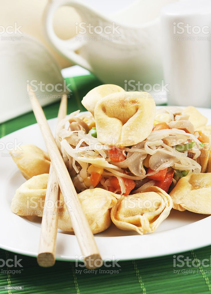 Deep fried asian noodles with vegetables stock photo