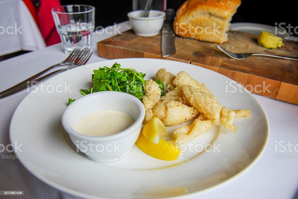 Deep fried calamari with tartar sauce, and cobb loaf stock photo