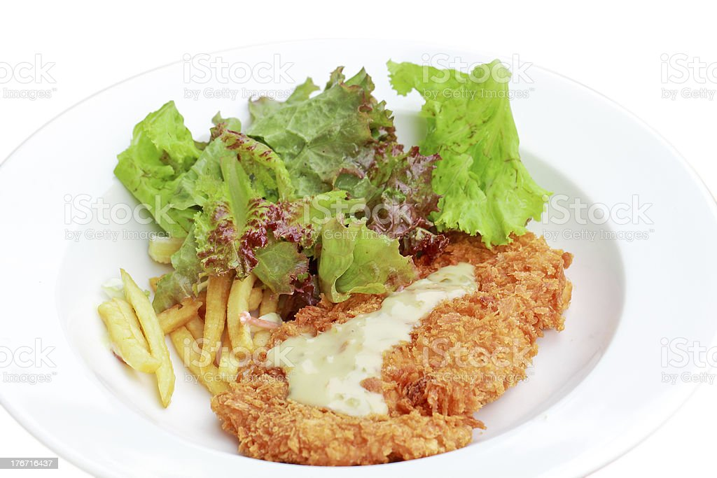 deep fried chicken steak with tomato and salad royalty-free stock photo