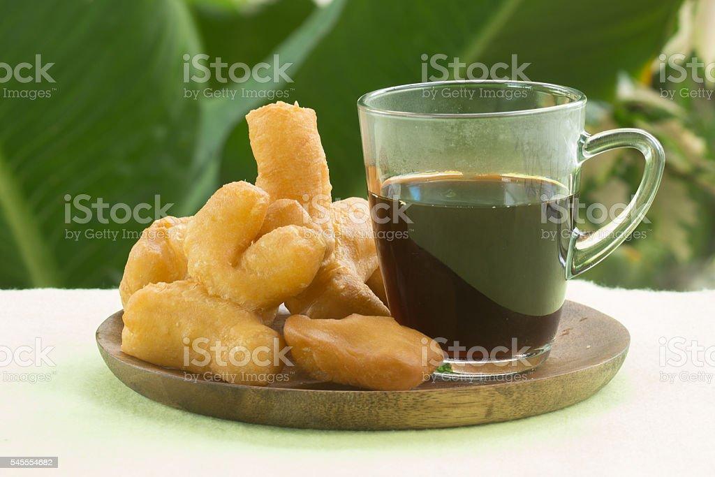 deep fried dough stick with black coffee stock photo