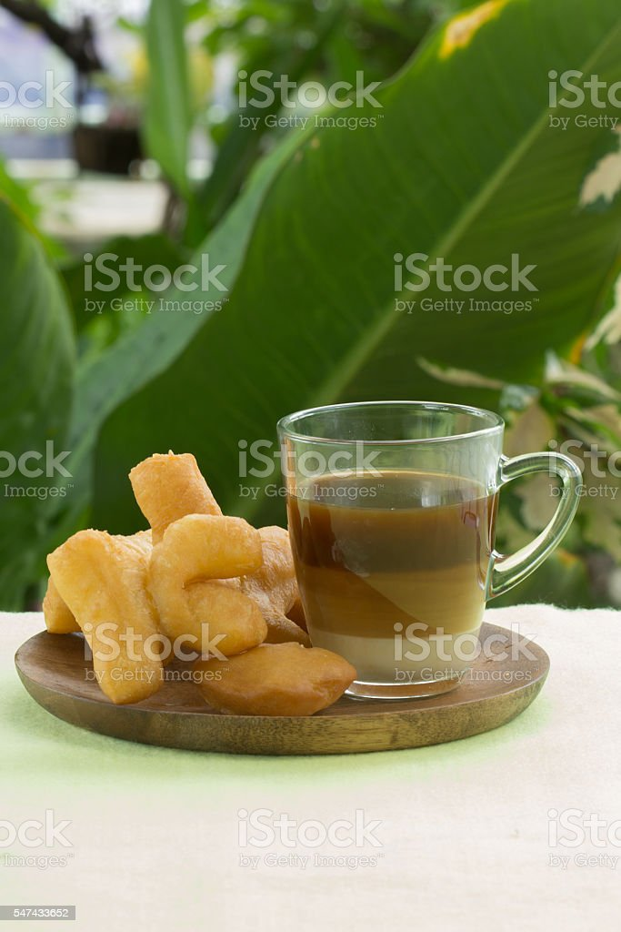 deep fried dough stick with hot coffee stock photo