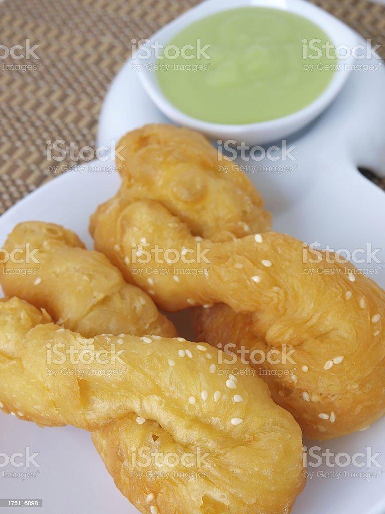 deep fried doughstick stock photo
