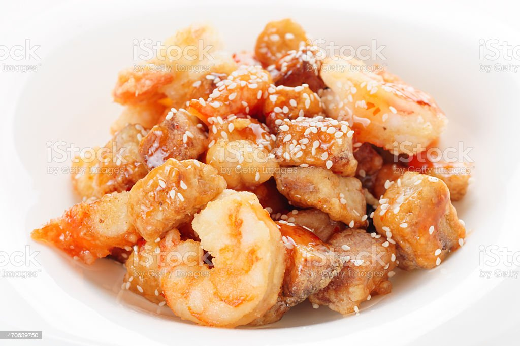 Deep fried eggplant and shrimps in sweet-sour sauce stock photo