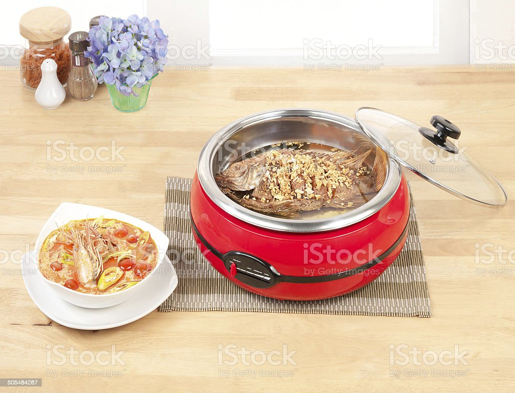 Deep fried fish and Shrimps spices soup stock photo