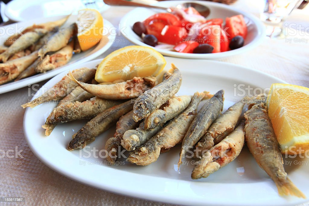 Deep fried fish with lemon royalty-free stock photo