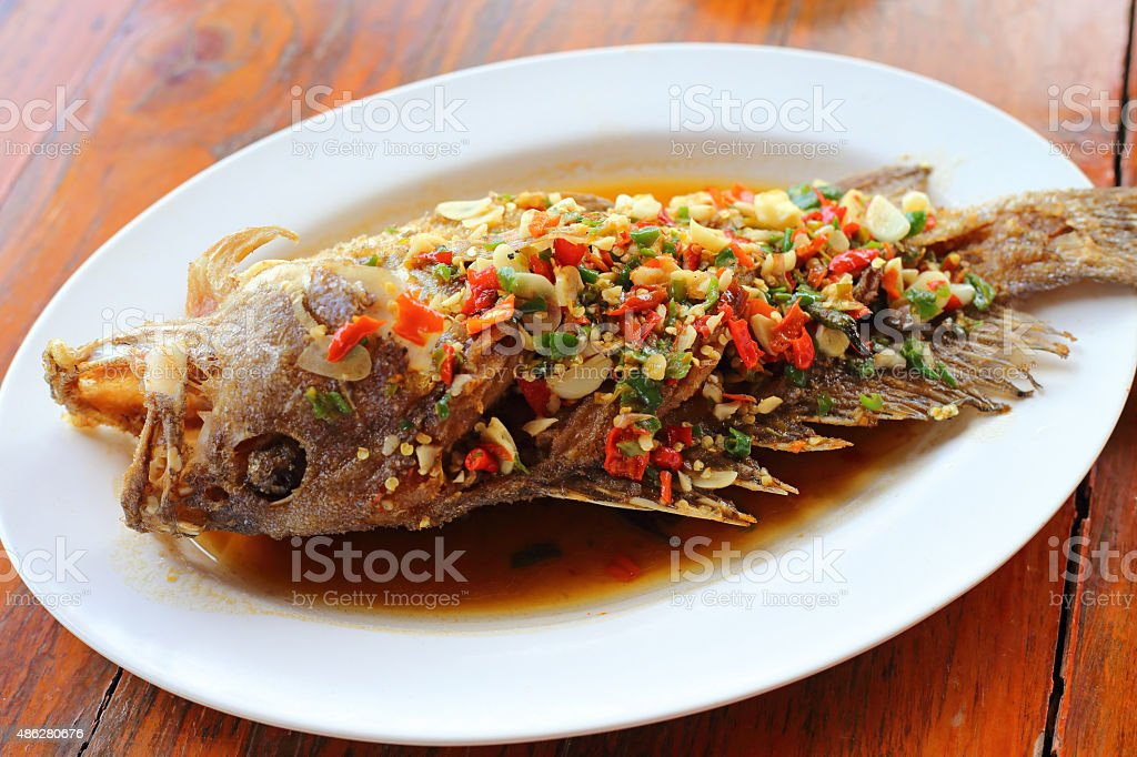 Deep fried grouper fish in chilly sauce stock photo
