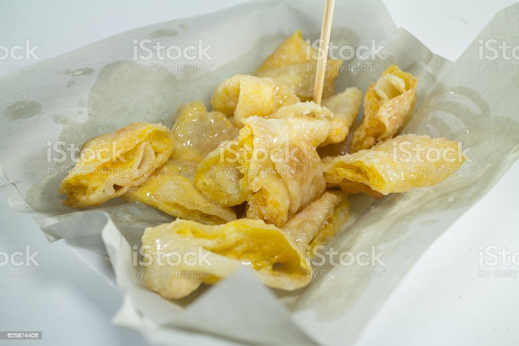 Deep fried of Crispy Roti served with sweetened condensed milk stock photo
