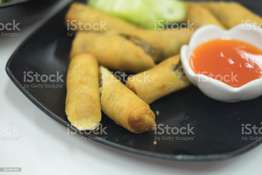 Deep fried spring rolls a Chinese cuisine on black plate stock photo