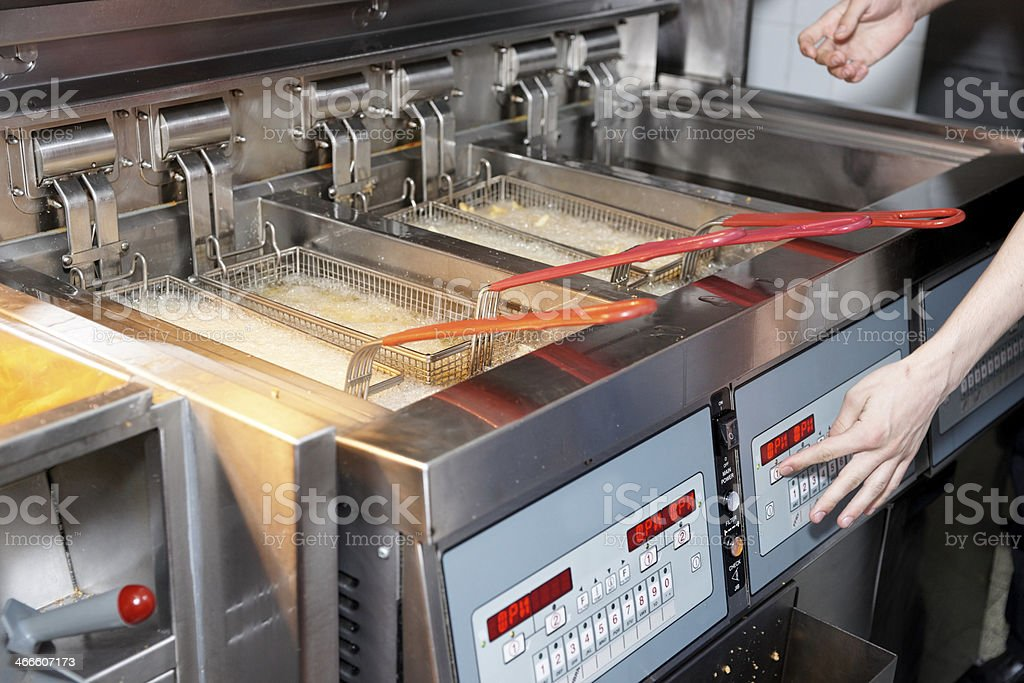 Deep fryers with boiling oil for a restaurant stock photo