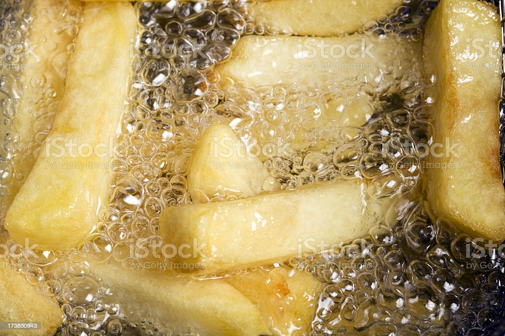 deep frying french fries royalty-free stock photo