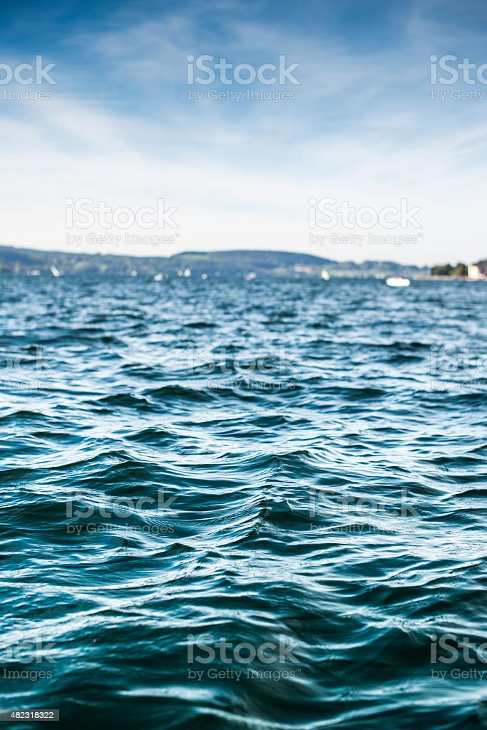 Deep green lake with selective focus on foreground stock photo