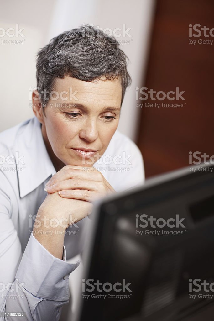 Deep in thought at the office royalty-free stock photo