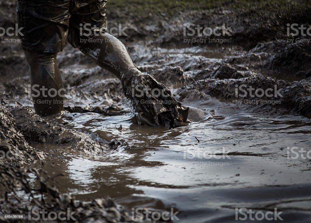 Deep muddy water with feet splashing throug stock photo