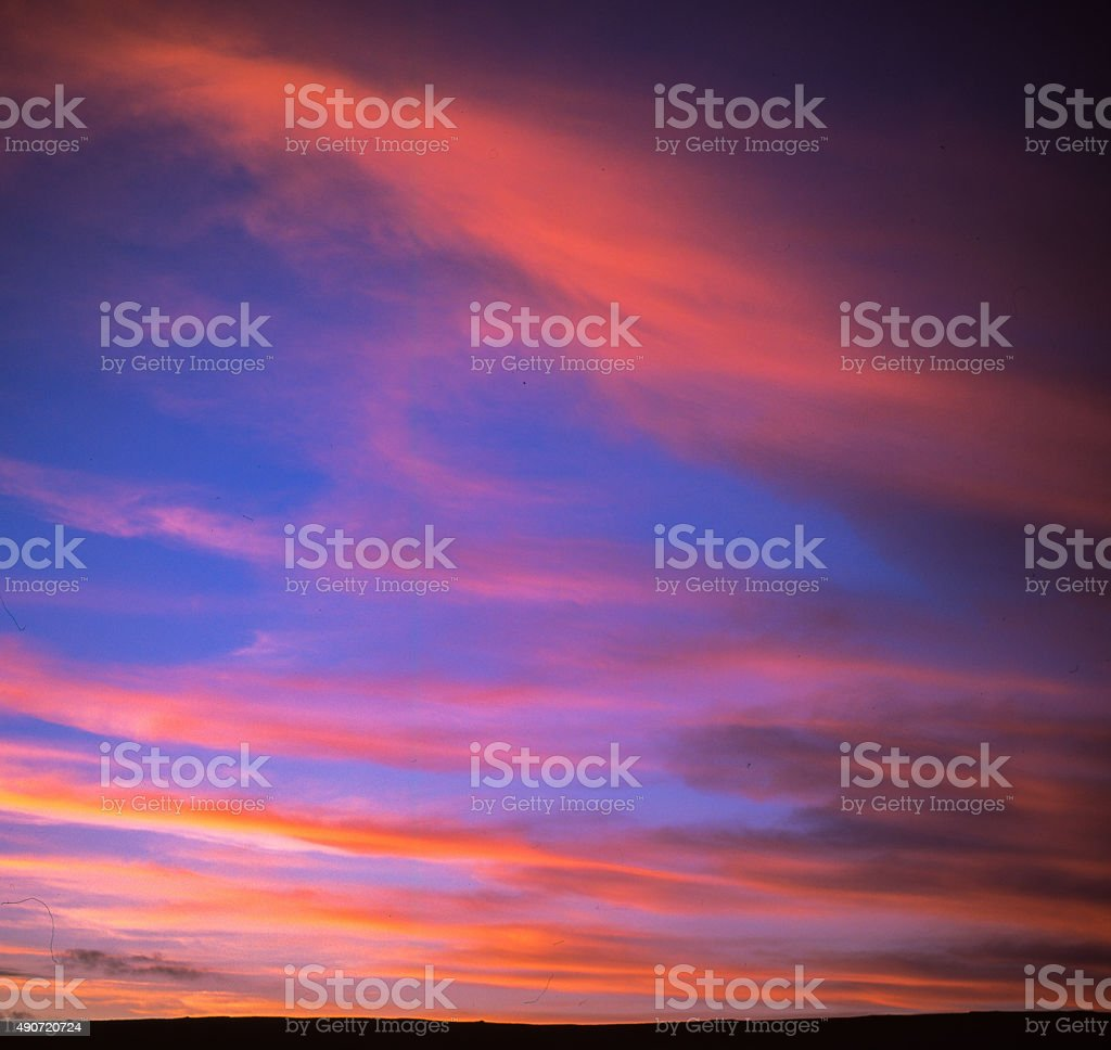 Deep red and deep blue sunset with lines of cloud royalty-free stock photo