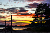 deep red dramatic sunset at beach volleyball area and lake