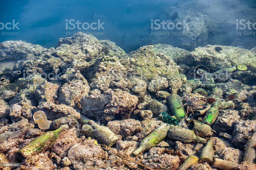 deep sea pollution...waste materials under sea stock photo