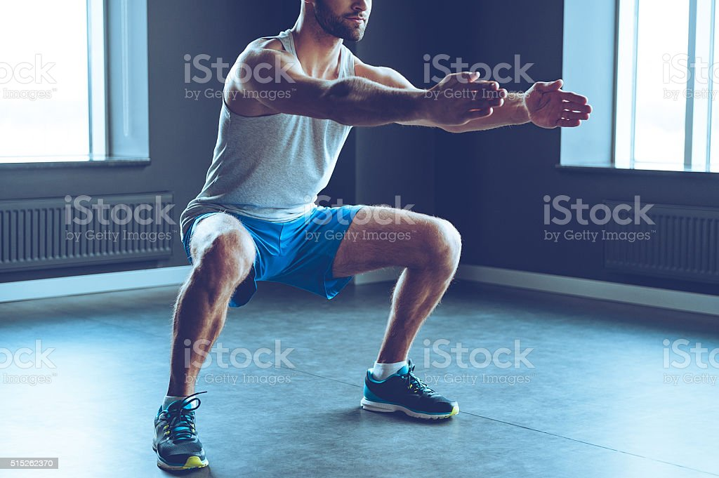 Deep squat. stock photo