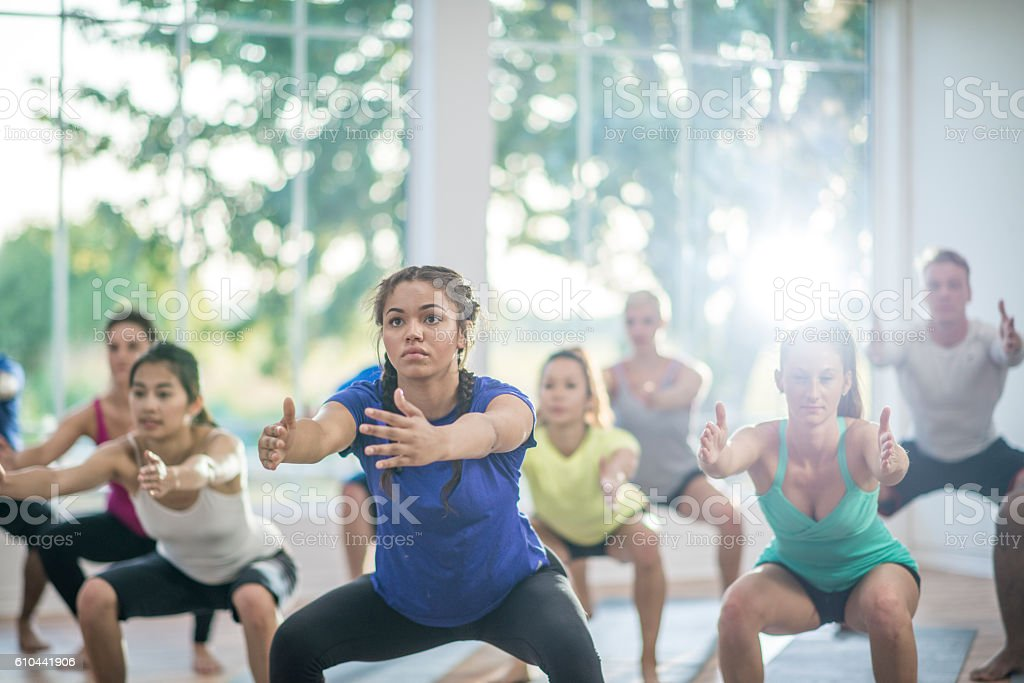 Deep Squats in a Fitness Class stock photo