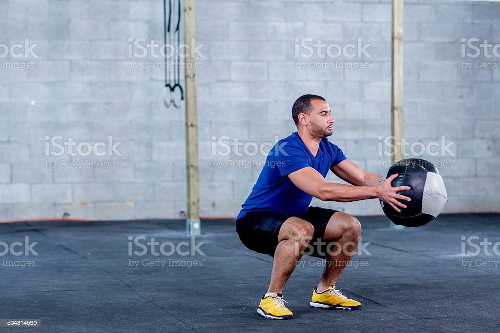 Deep Squats stock photo