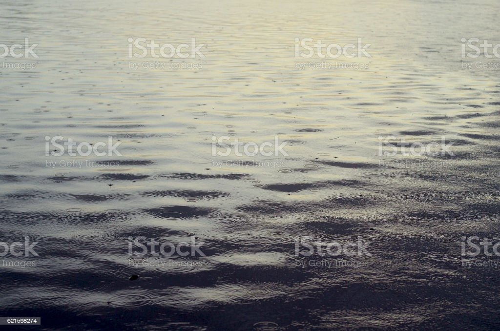 deep water surface and raindrops abstract nature background stock photo