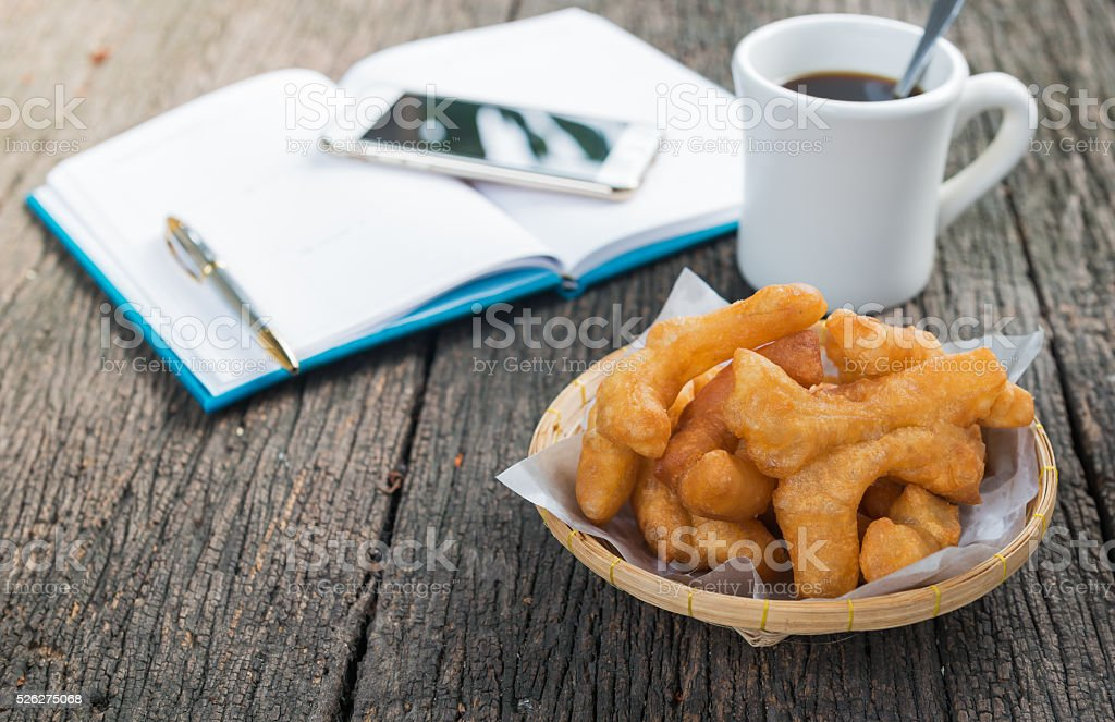deep-fried dough stick on wood background stock photo