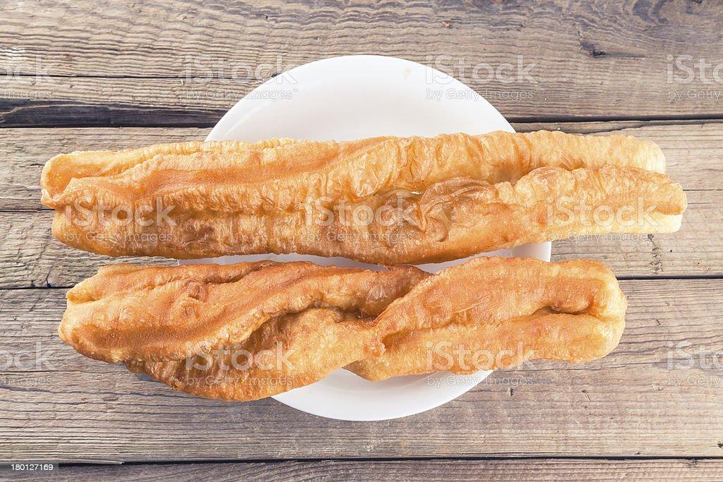 deep-fried dough sticks stock photo