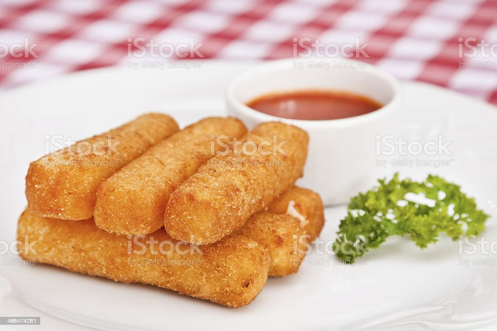 Deep-fried mozzarella cheese sticks stock photo