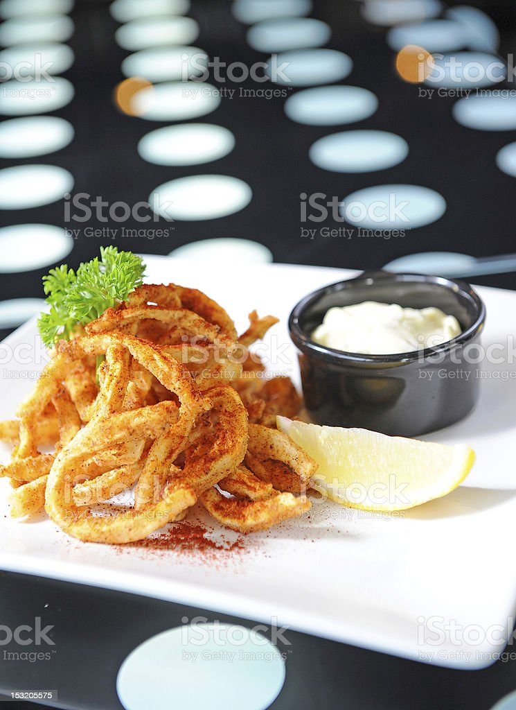 Deep-fried squid with sauce and lemon royalty-free stock photo