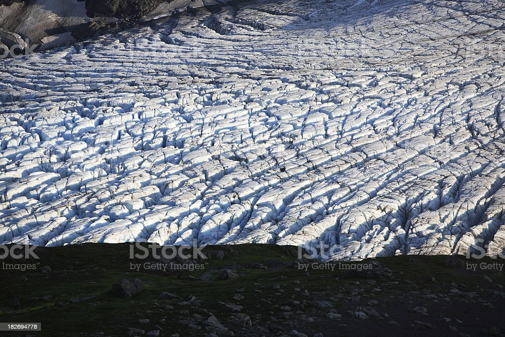 deeply crevassed glacier surface at sunset royalty-free stock photo