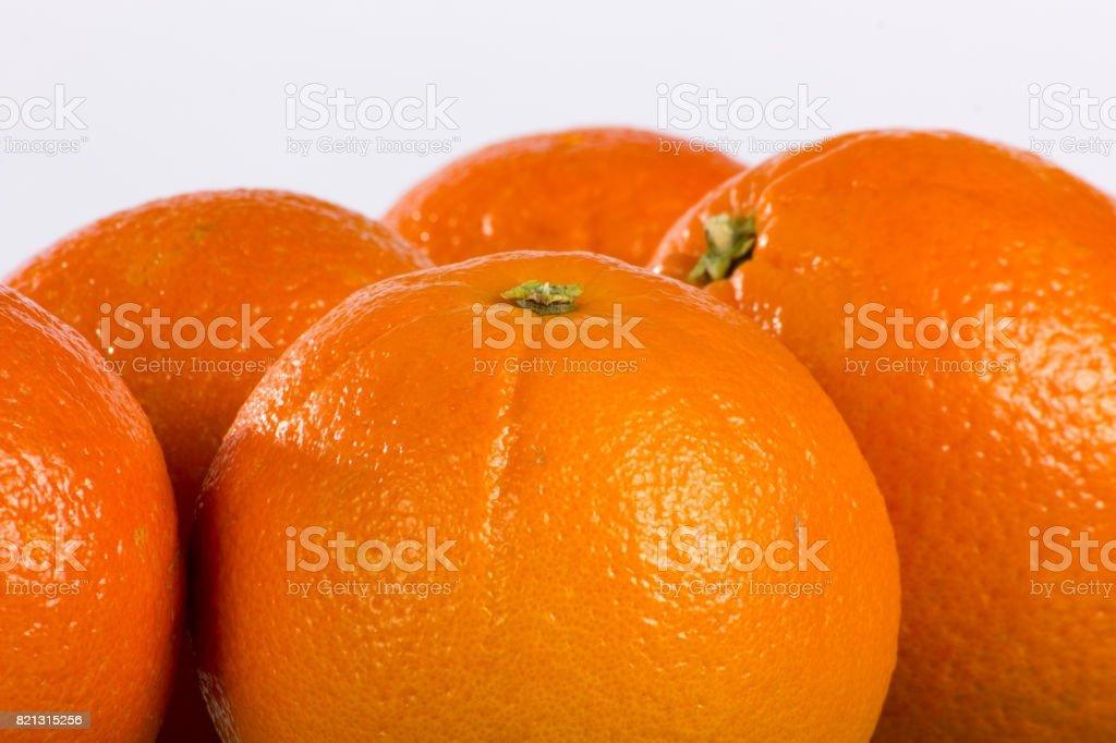 Deeply Orange Oranges Closeup on Plain Background stock photo